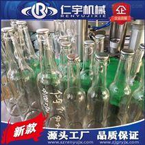 玻璃(li)瓶啤酒(jiu)拉環蓋封(feng)口機設備